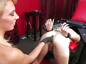 Drop out of sight crippling blondie Domme stunner rectally stimulates corded slave's prostate