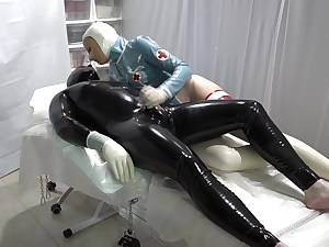 The spandex therapist is playing with the patient's penis